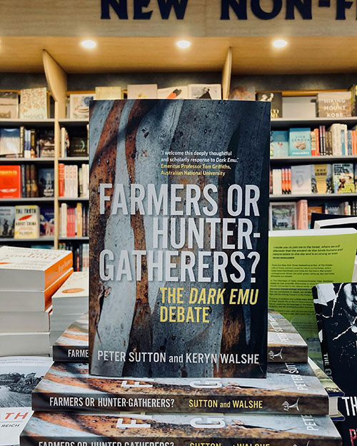 Farmers or Hunter-Gatherers? by Sutton and Walshe, showing the books on the shelf at Abbey's Bookshop